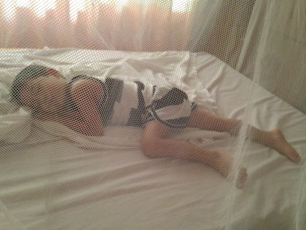 Sleeping under a mosquito net