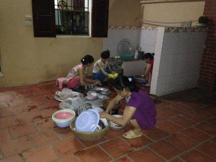 Women washing dishes in the courtyard