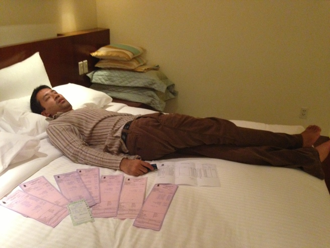 The sight of all our hotel receipts knocks Tom unconscious